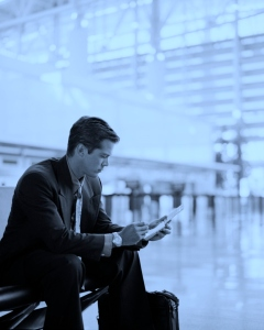 Businessman Making Electronic Notes in Airport