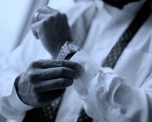 Businessman Buttoning Sleeve